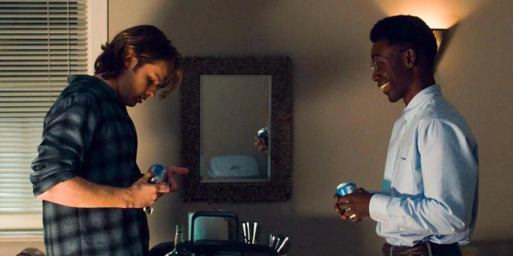 Dans le passé, Kevin et Randall face à face, jeunes adultes.